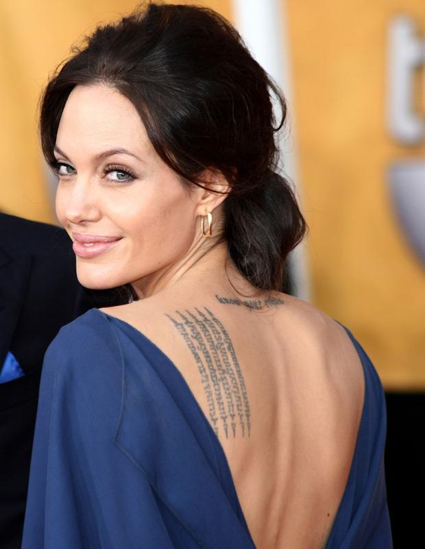 "Most things about Angelina Jolie make news. The metallic butterfly's body art is meaningful and interesting at the same time. She has the phrase ""know your rights"" tattooed below her long neck (quite apt for her rebellious nature). On the left side of her back, there is a prayer of protection, a Sanskrit blessing encrypted in Cambodian language in honour of her first adopted son Maddox.   With more than a dozen tattoos to decorate her body, its become a headache to portray her naked skin on screen."