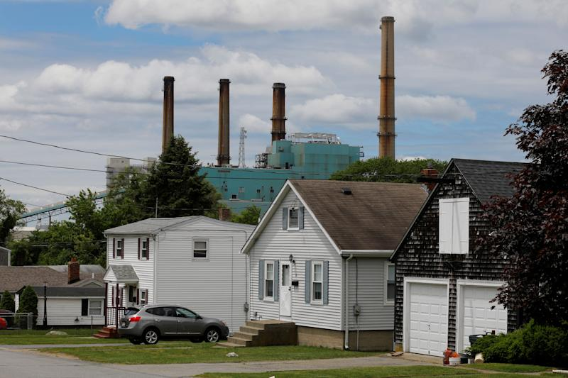 The Brayton Point power plant, a coal-fired power plantthat was shut downJune 1,rises behind houses in Somerset, Massachusetts.