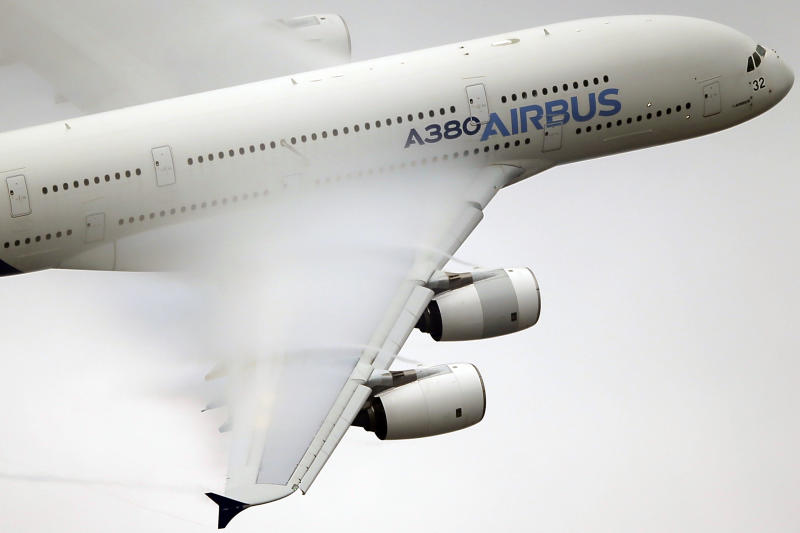 Vapor forms across the wings of an Airbus A380 as it performs a demonstration flight at the Paris Air Show, Le Bourget airport, north of Paris in 2015.