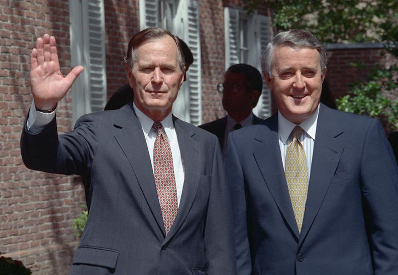 <p>Bush waves to the camera as Mulroney smiles beside him as the two were taking part in an economic summit in Houston in July 1990. Photo from Getty Images. </p>