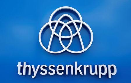 Thyssenkrupp's logo is seen close to the elevator test tower in Rottweil, Germany, September 25, 2017. REUTERS/Michaela Rehle