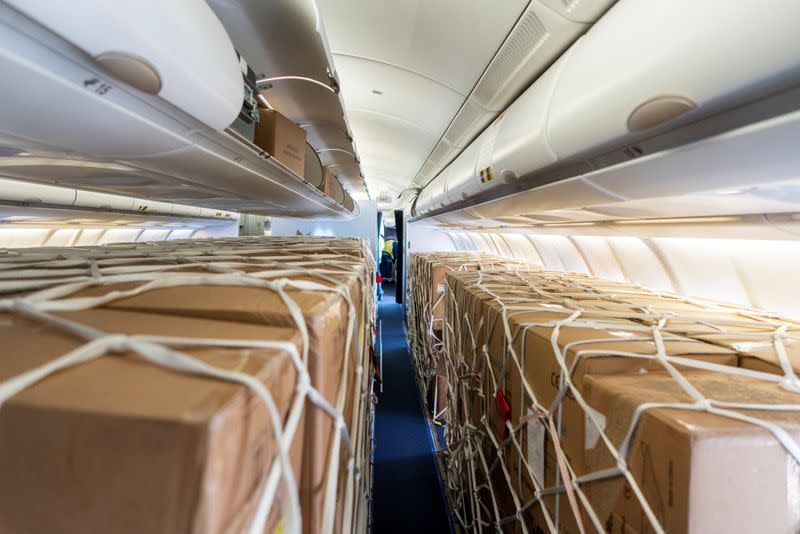 Crisis-torn airlines scramble to convert empty cabins to cargo