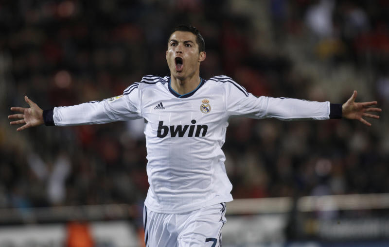 Real Madrid's Cristiano Ronaldo from Portugal celebrates during La Liga soccer match against Mallorca at the Iberostar stadium in Palma de Mallorca, Spain, Sunday, Oct. 28, 2012. (AP Photo/Manu Mielniezuk)