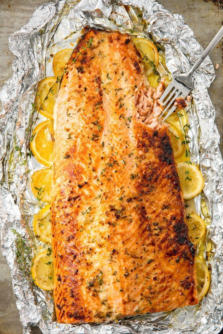 """<p>This healthy baked salmon is the best way to feed a crowd. There's no pan cooking at all—everything is oven-baked in foil, making prep and cleanup a breeze. Considering how beautiful, easy, and delicious this hunk of fish is, we believe it might just be the best baked salmon recipe IN THE WORLD. </p><p>Get the <a href=""""https://www.delish.com/uk/cooking/recipes/a28996578/best-baked-salmon-recipe/"""" rel=""""nofollow noopener"""" target=""""_blank"""" data-ylk=""""slk:Baked Garlic-Butter Salmon"""" class=""""link rapid-noclick-resp"""">Baked Garlic-Butter Salmon</a> recipe.</p>"""