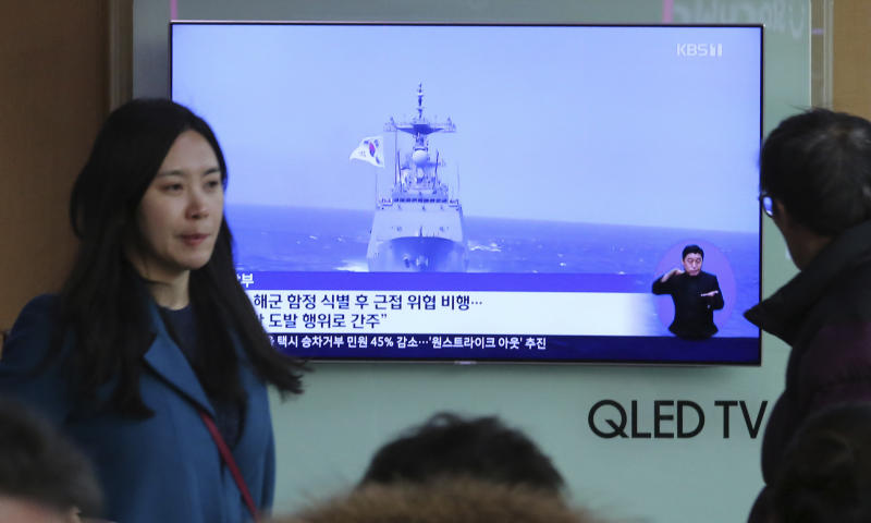 "A TV screen shows file footage of a South Korean warship during a news program at the Seoul Railway Station in Seoul, South Korea, Wednesday, Jan. 23, 2019. South Korea's military accused Japan of a ""clear provocation"" over what it said was a threatening low-altitude flight by a Japanese patrol plane over a South Korean warship on Wednesday. The Korean letters on the screen read: ""South Korea's military accused Japanese patrol plane of threatening flight"". (AP Photo/Ahn Young-joon)"