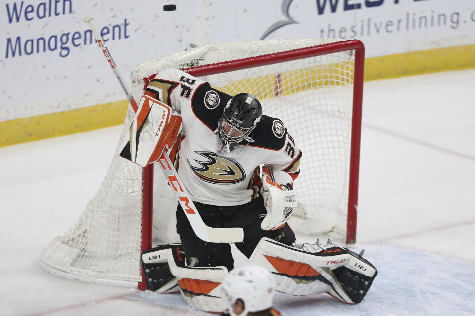 Anaheim Ducks' goalie John Gibson (36) blocks the puck from the net against the Minnesota Wild during the first period of an NHL hockey game Friday, May 7, 2021, in St. Paul, Minn. (AP Photo/Stacy Bengs)