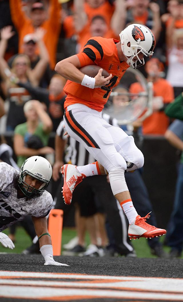 Oregon State quarterback Sean Mannion (4) scores a touchdown against Portland State during the second quarter of an NCAA college football game in Corvallis, Ore., Saturday, Aug. 30, 2014. (AP Photo/Troy Wayrynen)