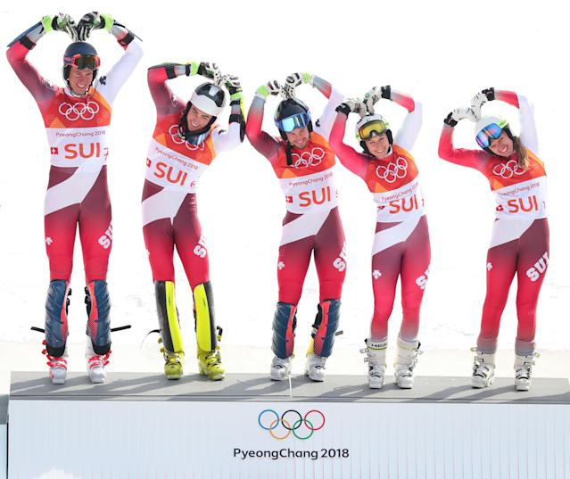 <p>Gold medallists Switzerland with (L-R) Ramon Zenhaeusern, Daniel Yule, Luca Aerni, Wendy Holdener and Denise Feierabend celebrate during the victory ceremony for the Alpine Team Event Big Final on day 15 of the PyeongChang 2018 Winter Olympic Games at Yongpyong Alpine Centre on February 24, 2018 in Pyeongchang-gun, South Korea. (Photo by Tom Pennington/Getty Images) </p>