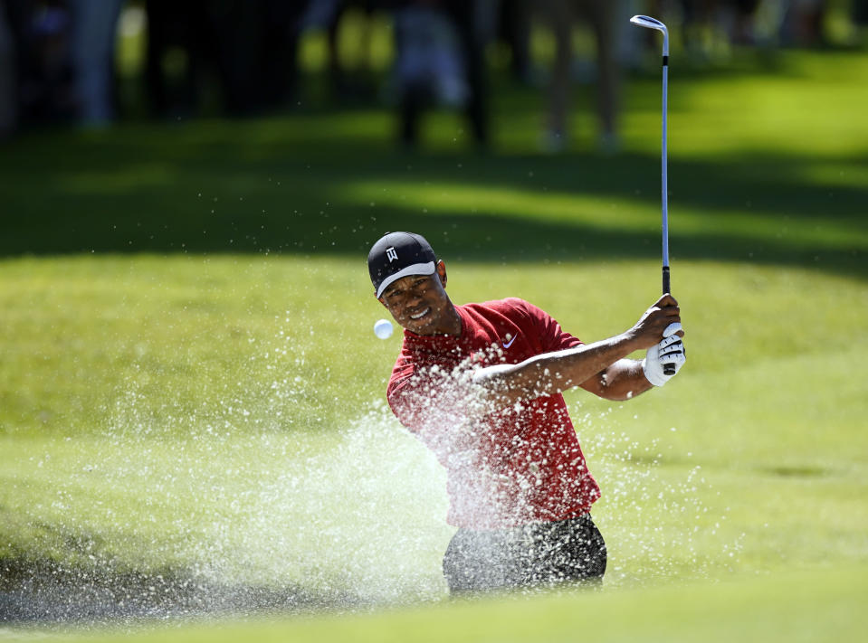 Tiger Woods hits out of a greenside bunker on the 17th hole during the final round of the Genesis Invitational golf tournament at Riviera Country Club, Sunday, Feb. 16, 2020, in the Pacific Palisades area of Los Angeles. (AP Photo/Ryan Kang)