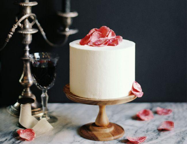 "<p>Sprinkle candied rose petals on a plain white cake for your most elegant Valentine's Day affair—the effortless beauty of this simple dessert is enough to make anyone swoon. </p><p><em>Via <a href=""http://www.inspiredbythis.com/dwell/diy-sugar-rose-petals-valentines-day/"" rel=""nofollow noopener"" target=""_blank"" data-ylk=""slk:Inspired by This"" class=""link rapid-noclick-resp"">Inspired by This</a> </em></p><p><a class=""link rapid-noclick-resp"" href=""https://go.redirectingat.com?id=74968X1596630&url=https%3A%2F%2Fwww.williams-sonoma.com%2Fproducts%2Fwedding-lace-cake-6in%2F%3FcatalogId%3D21%26sku%3D1320491%26cm_ven%3DPLA%26cm_cat%3DGoogle%26cm_pla%3DFood%2B%253E%2BCakes%252C%2BCupcakes%2B%2526%2BPies%26cm_ite%3D1320491%26gclid%3DCj0KCQiAsvTxBRDkARIsAH4W_j9c76_7pXRsH2F6w5U81iWJFeqOFd3F3FoE1ircVzV4J9Unce5SdMIaAi-sEALw_wcB&sref=https%3A%2F%2Fwww.elledecor.com%2Flife-culture%2Ffun-at-home%2Fg2387%2Fvalentines-day-decor%2F"" rel=""nofollow noopener"" target=""_blank"" data-ylk=""slk:GET THE LOOK"">GET THE LOOK</a><em><br>The Cake Bake Shop's Two-Tier Cake, Williams Sonoma, $300</em></p>"