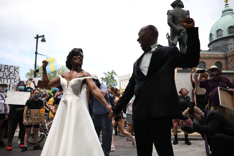 Newlyweds Dr Kerry Anne and Michael Gordon joined the Black Lives Matter protests in Philadelphia. Photo: AP