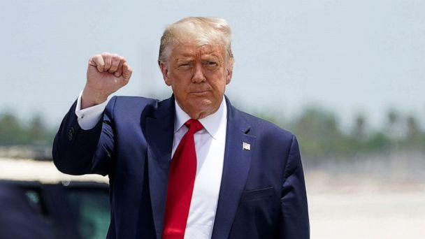 PHOTO: President Donald Trump pumps his fist as he arrives at Miami International Airport in Miami, July 10, 2020. (Kevin Lamarque/Reuters)