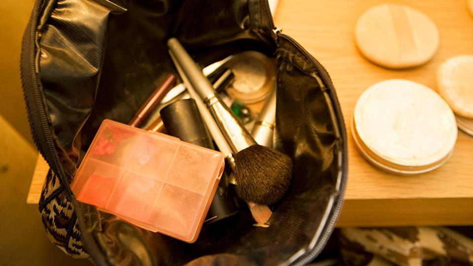 Makeup Bag and Cosmetics on Tabletop. Photo: Getty Images.
