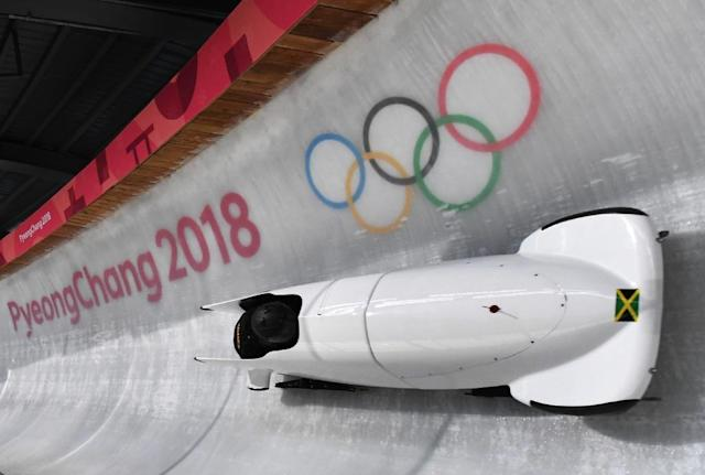 Team leader and driver Jazmine Fenlator-Victorian of Jamaica corners in the second women's unofficial bobsleigh training session at the Olympic Sliding Centre ahead of the Pyeongchang 2018 Winter Olympic Games (AFP Photo/Mark Ralston)