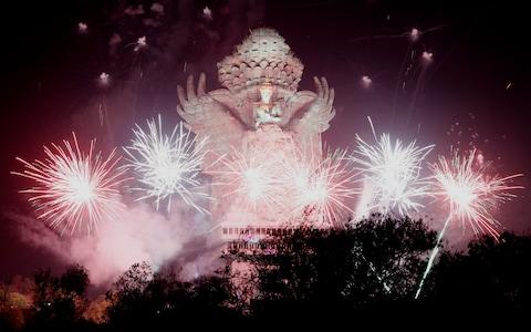 <span>Fireworks explode after midnight over Garuda Wisnu Kencana cultural park part of New Year celebrations in Bali, Indonesia </span> <span>Credit: Rex </span>