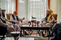 The Haqqani network leader's younger brother Anas Haqqani (R) has held talks with former president Hamid Karzai after the fall of Kabul