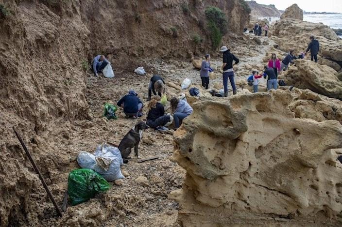 <p>Clean-up operation will continue for a 'long period of time', officials say</p> (Associated Press)
