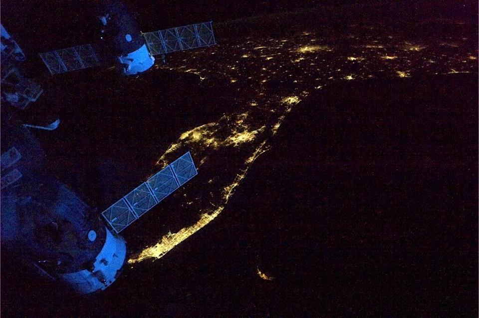 """Spaceships glowing blue in the dawn as we leave Florida headed across the Atlantic. <a href=""""https://twitter.com/Cmdr_Hadfield/"""" rel=""""nofollow noopener"""" target=""""_blank"""" data-ylk=""""slk:(Photo by Chris Hadfield/Twitter)"""" class=""""link rapid-noclick-resp"""">(Photo by Chris Hadfield/Twitter)</a>"""
