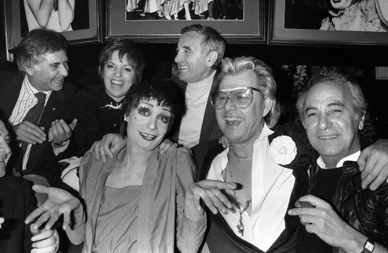 Michou (second right) parties at his cabaret in 1986 with American star Liza Minnelli (second left), French singer Charles Aznavour and actor Jean-Claude Brialy