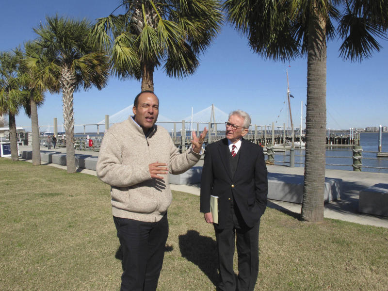International African-American Museum President Michael Moore, left, and former Charleston Mayor Joe Riley, right, discuss the new museum to be built over the next three years in Charleston, S.C., on Monday, Jan. 30, 2017. The museum is being built on this site where nearly half of all the slaves who came in the U.S. first stepped on American soil. (AP Photo/Jeffrey Collins)