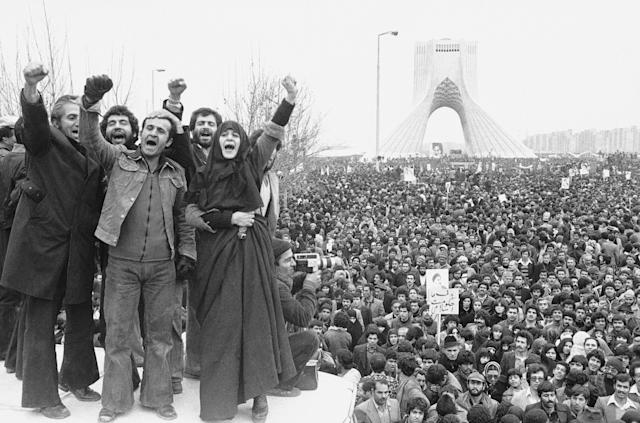 FILE - In this Jan. 19, 1979 file photo, more than a million supporters of an Islamic Republic assembled around the Shayad monument, in Tehran, Iran. Wednesday, Jan. 16, 2019 marks the 40th anniversary of the shah abandoning his Peacock Throne and leaving his nation for the last time in his life, setting the stage for the country's 1979 Islamic Revolution only a month later. (AP Photo/Aristotle Saris, File)