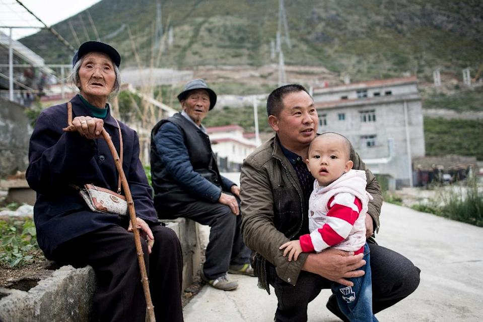 China's plans to boost its hydropower will mean some 6,000 people across four counties will be relocated, according to a state-affiliated energy website. (AFP Photo/Johannes EISELE)