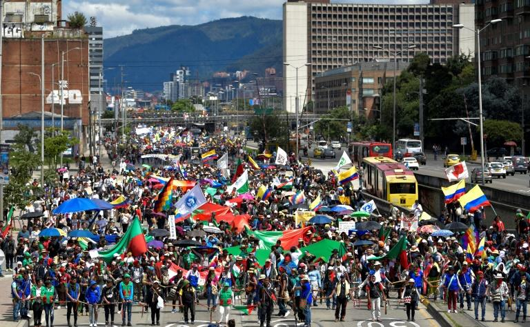 Indigenous people and students take part in a protest in Bogota against the government of Colombian President Ivan Duque