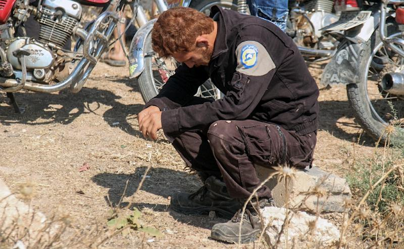 A member of Syria's White Helmets rescue service mourns at the funeral of seven colleagues shot dead in a dawn raid on their base in the jihadist-held northwestern town of Sarmin on August 12, 2017 (AFP Photo/OMAR HAJ KADOUR)