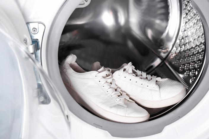 It's a good idea to wear shoes that are machine washable. Some athletic shoes can be tossed in the washing machine. (Photo: belchonock via Getty Images)