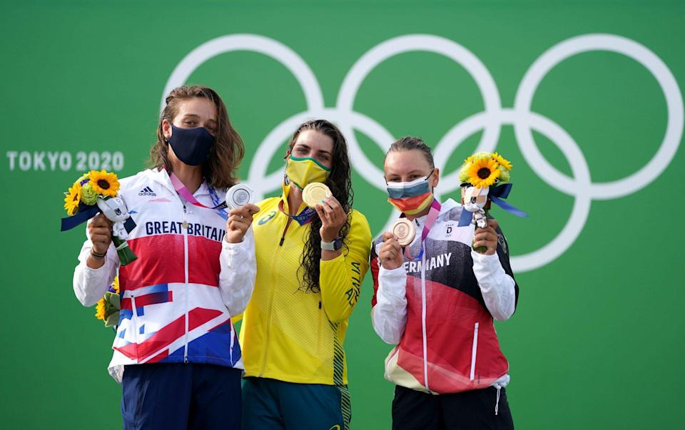 Australia's Jessica Fox (centre), Great Britain's Mallory Franklin (left) and Germany's Andrea Herzog (right) show off their medals - PA