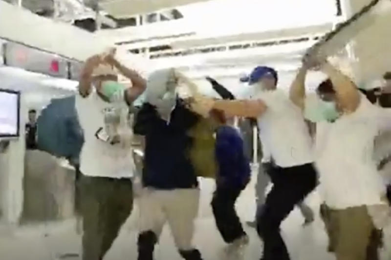 In this image taken from a video footage run by The Stand News via AP Video, white shirted men attack a man dressed in black shirt at a subway station in Hong Kong on Sunday, July 21, 2019. China doesn't want to intervene in Hong Kong's protests but that doesn't mean it won't, as a thuggish attack on the protesters brought accusations of connivance between police and criminal gangs. (The Stand News via AP Video) HONG KONG OUT