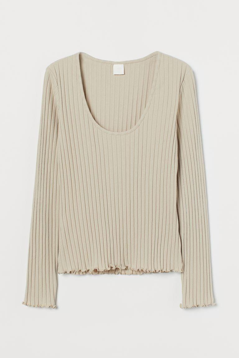 <p>This <span>Ribbed Jersey Top</span> ($10) is the neutral layering piece your fall closet needs.</p>