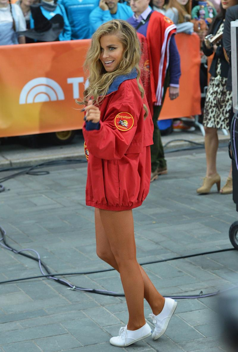 Carmen Electra poses in a red jacket