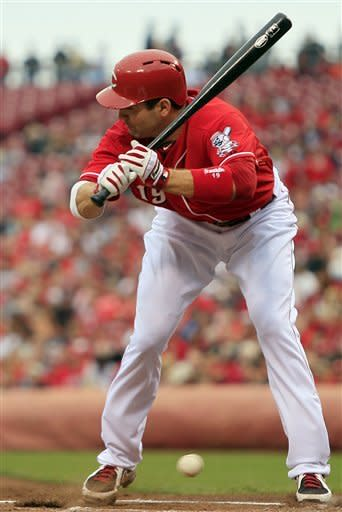 Cincinnati Reds' Joey Votto is brushed off the plate by a low pitch in the first inning of a baseball game against the Milwaukee Brewers, Thursday, Sept. 27, 2012, in Cincinnati. (AP Photo/Al Behrman)