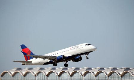 FILE PHOTO: A Delta Airlines jet takes off from Washington National Airport in Washington, U.S., August 9, 2017.   REUTERS/Joshua Roberts/File Photo