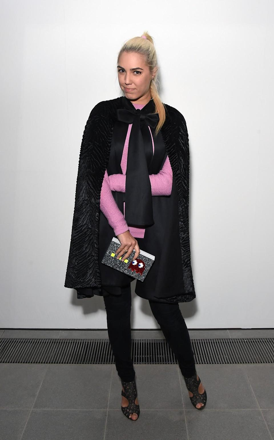 <p>Amber Le Bon donned a pink knit and bow-tied cape. <i>[Photo: Getty]</i> </p>