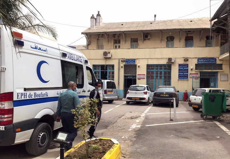 An ambulance is parked outside the infectious diseases department at Boufarik Hospital