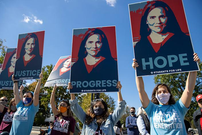 WASHINGTON, DC - OCTOBER 17: Supporters of Supreme Court nominee Judge Amy Coney Barrett show their support outside the Supreme Court on October 17, 2020 in Washington, DC. Demonstrators and supporters took to the streets in honor of the late Supreme Court JusticeRuth Bader Ginsburg and to protest President Donald Trump's nomination of Judge Amy Coney Barrett to the Supreme Court before the November election. (Photo by Tasos Katopodis/Getty Images)