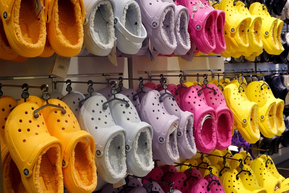 CHICAGO, ILLINOIS - JULY 22: Footwear is offered for sale at a Crocs retail store on July 22, 2021 in Chicago, Illinois. Crocs Inc. today reported second-quarter net income of $319 million, topping Wall Street expectations. (Photo by Scott Olson/Getty Images)