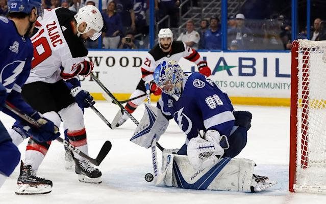 Andrei Vasilevskiy of the Tampa Bay Lightning makes a save against Travis Zajac of the New Jersey Devils as the Lightning beat the Devils 3-1 to close out their opening round playoff series (AFP Photo/Mike Carlson)