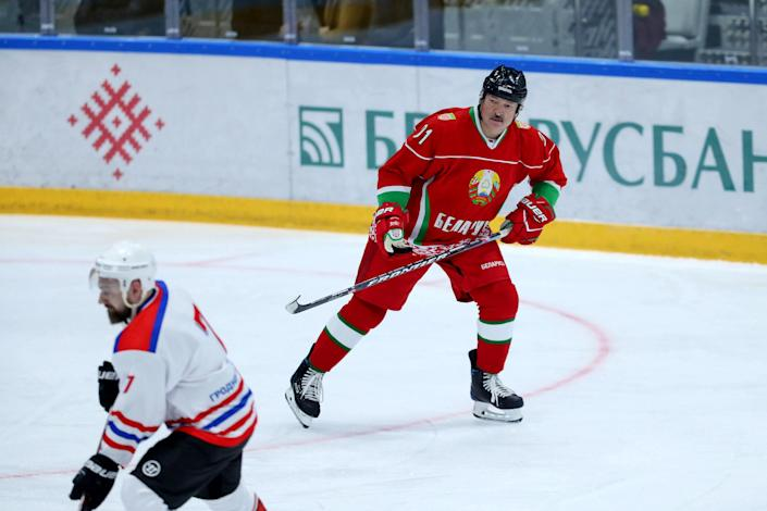 Image: Belarusian President Alexander Lukashenko plays in a hockey game in Minsk on Saturday. (Andrey Pokumeiko / BelTA / via Reuters)