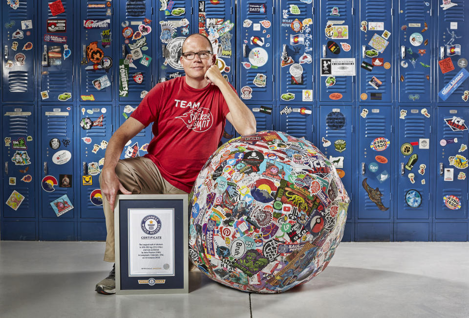 <p>John Fischer from the States achieved this record, with a sticker ball weighing 105.052kg (231.6lbs) (PA) </p>