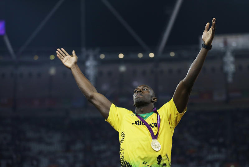 Jamaica's Usain Bolt celebrates winning the gold medal in the men's 200-meter final during the athletics in the Olympic Stadium at the 2012 Summer Olympics, London, Thursday, Aug. 9, 2012. (AP Photo/Matt Slocum)