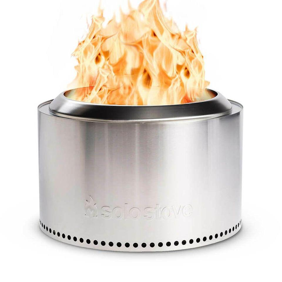 """<p><strong>Solo Stove</strong></p><p>solostove.com</p><p><strong>$499.99</strong></p><p><a href=""""https://go.redirectingat.com?id=74968X1596630&url=https%3A%2F%2Fwww.solostove.com%2Fsolo-stove-yukon%2F&sref=https%3A%2F%2Fwww.housebeautiful.com%2Fshopping%2Fhome-accessories%2Fg32129002%2Fbest-fire-pit%2F"""" rel=""""nofollow noopener"""" target=""""_blank"""" data-ylk=""""slk:BUY NOW"""" class=""""link rapid-noclick-resp"""">BUY NOW</a></p><p>Not a fan getting a fire smell in your hair? This fire pit produces a smoke-free fire in minutes. The wood-burning pit has a 23-inch opening, and its stainless steel design would make a chic addition to any backyard style.</p>"""