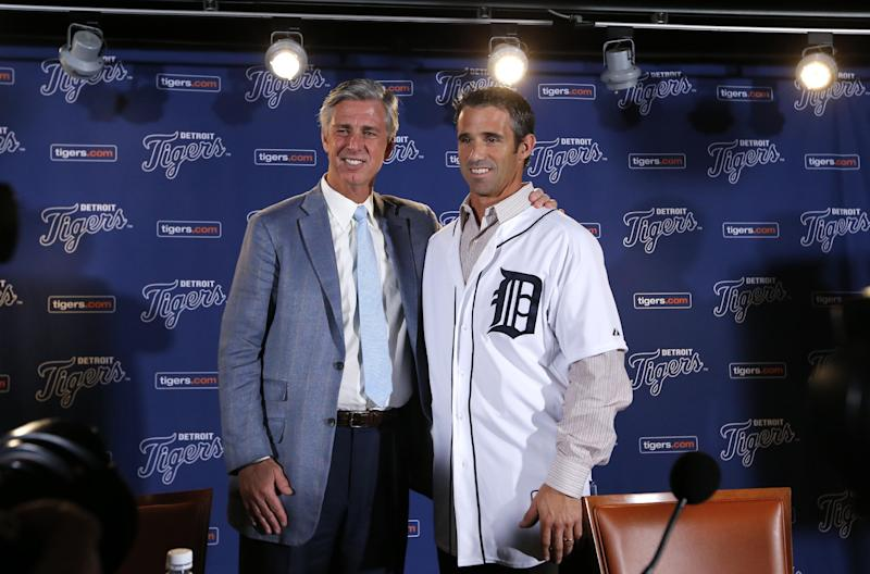 Detroit Tigers general manager David Dombrowski, left, introduces Brad Ausmus as the new Detroit Tigers manager during a news conference in Detroit Sunday, Nov. 3, 2013. Ausmus replaces Jim Leyland who stepped down as manager. AP Photo/Paul Sancya)