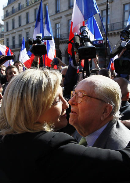 French far-right politician Jean Marie Le Pen, right kisses his daughter, France's far-right National Front candidate for the presidential election Marine Le Pen prior to a wreath-laying ceremony at the statue of Joan of Arc, during the traditional May Day march in Paris, Tuesday May 1, 2012. After Socialist party candidate Francois Hollande won a slim upper hand in the first round of voting, President and conservative candidate Nicolas Sarkozy candidly ogled voters of the far-right National Front whose candidate, Marine Le Pen, placed a solid third. (AP Photo/Francois Mori)