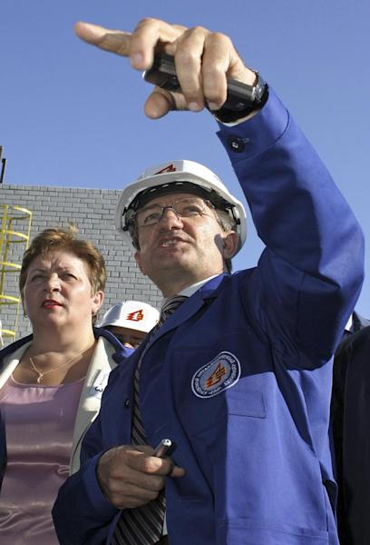 In this photo taken Aug. 22, 2005, Ukrainian oligarch Sergyi Taruta visits a metallurgical plant in Donetsk, Ukraine. For years, Ukraine's business tycoons have challenged the central authorities in Kiev, fighting, plotting and scheming to enlarge and maintain their multimillion-dollar empires. But when President Vladimir Putin's troops invaded the pro-Russian strategic Black Sea peninsula of Crimea and held massive military exercises near the border with eastern Ukraine, the country's richest men put their rivalries aside, rallied behind the new government in Kiev and took up governors' posts in the east of the country to counter possible Russian aggression there. (AP Photo/SergeI Vaganov)