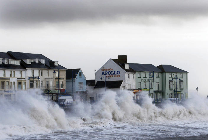 Waves hit the sea wall in Porthcall, south Wales (REUTERS/Eddie Keogh)