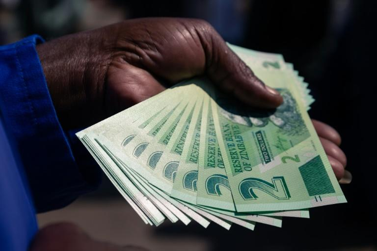 New Zimbabwe two-dollar notes have been issued to help ease a chronic cash shortage in the country