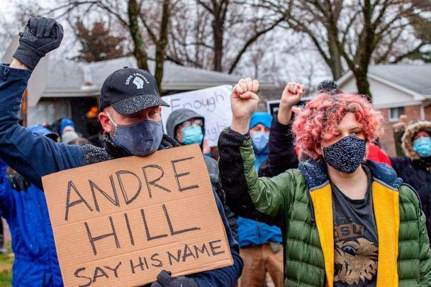 PHOTO: Protesters raise their fists and observe a moment of silence during a demonstration against the police killing of Andre Hill in the neighborhood where Hill was shot, in Columbus, Ohio on Dec. 24, 2020. (Stephen Zenner/AFP via Getty Images, FILE)